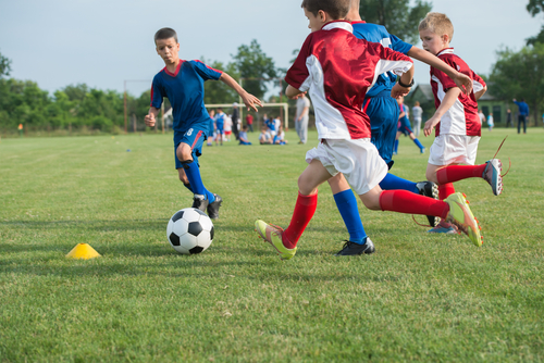 9 ways to help your child excel at a sport at a young age